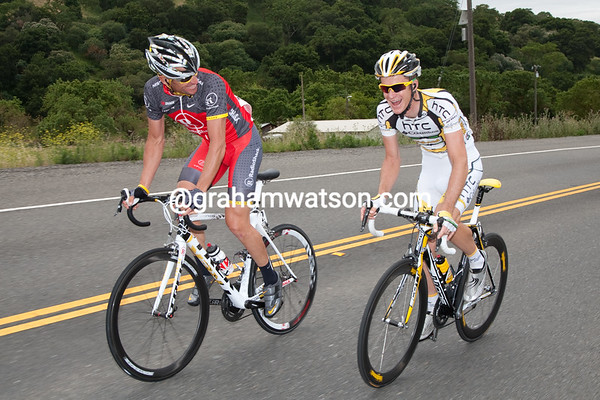 """...while at the front, Lance and Mick joke about attacking the peeing peloton, """"I will if you will..."""" Lance jokes."""