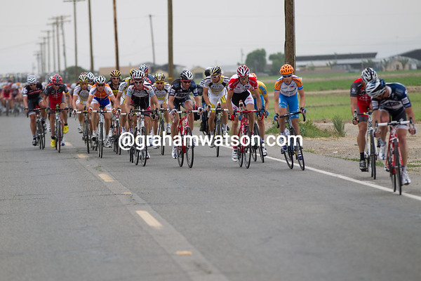 ...now into a block headwind, the peloton re-combines to finish the chase for the break.