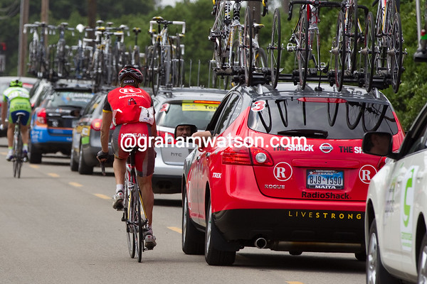Rubiera is at the car, and Bruyneel does not look happy... Is Chechu heading back to shepherd someone up?