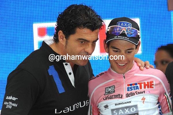 Big star, little star - Richie Porte is greeted by ski legend Alberto Tomba on the podium...