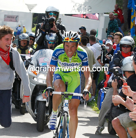 Basso is looking frighteningly strong as he hears the finish...