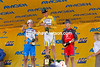 The overall GC podium - Dave Z seems to be coaching the others on where to send the champagne....