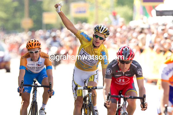 Michael Rogers raises his fist as he crosses the line. He secured his victory by staying with Zabriskie and Leipheimer today.