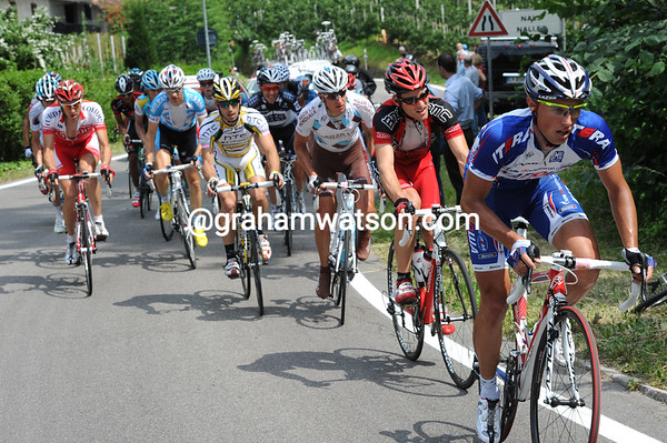 Mikhail Ignatiev leads the escape on to the day's 18-kilometre ascent with a lead of 12 minutes over the peloton...