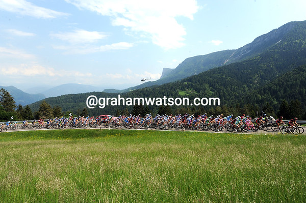 The peloton is in pursuit but going gently enough to enjoy the Trentino scenery...