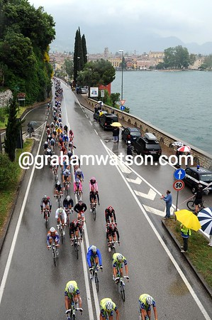Sky, HTC and Liquigas lead a strung-out peloton alongside Lake Garda...