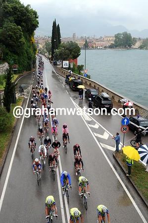 Sky, HTC and Liquigas lead a strung-out peloton alongside Lake Garda...