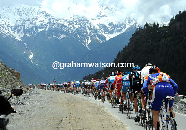 A nice day for a bike race - the peloton descends towards the Swiss border at great speed and with great scenery...