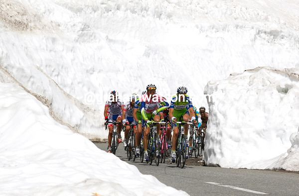 There they are - the Liquigas-led peloton finds its way through the banks of snow as well...