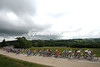 Stormy skies hang over the peloton that has yet to react...
