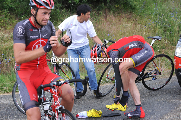 """Chris Horner is nervous today - the Shack team leader wants to shed his overshoes but gets flustered: Thomas Vaitkus has that """"I've seen it all before"""" look about him as he waits..."""
