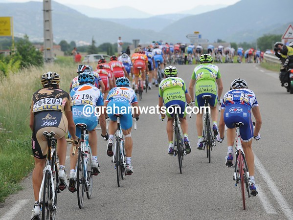 The race emerges from the official start into some brutal winds - the peloton splits up...