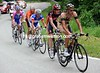 The magnificent seven are lead onto the Chamrousse climb by Eros Capecchi...