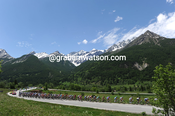 The race is on a few kilometres from the start as the peloton attacks the Col de Lautaret...