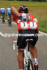 How the mighty fall - Fabian Cancellara collects water bottles for his teamates...