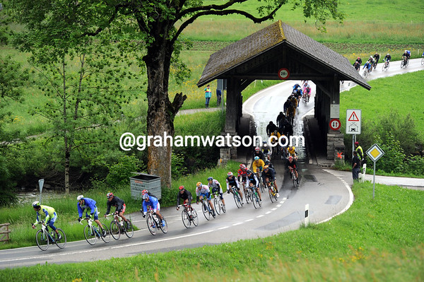 The peloton is in full pursuit on the rolling roads of the Berner Oberland....