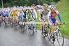 The peloton is chasing gently at first, but those five escapers are big, strong men...