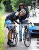 David Zabriskie makes a bike change on a wet descent...