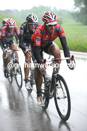 Unlike his rival, Fabian Cancellara is enjoying the wet conditions today...and he's smiling!