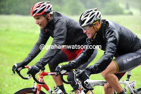 Lance Armstrong isn't exactly laughing, but that's definitely a smile growing on his wet face...