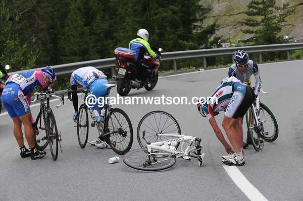 There's been a crash on a fast downhill section of the race - Hoste, Furlan and Vande Velde are victims...