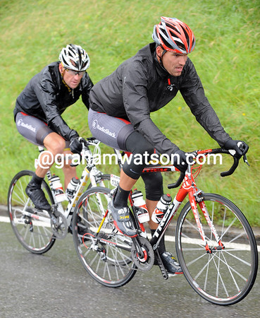 It's another wet and cold day at the office for Gert Steegmans and his leader, Lance Armstrong...