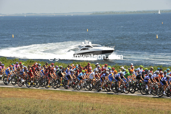 Power to the peloton - a high-powered speedboat tries to keep pace as the peloton crosses the Zeeland coast for the second time...