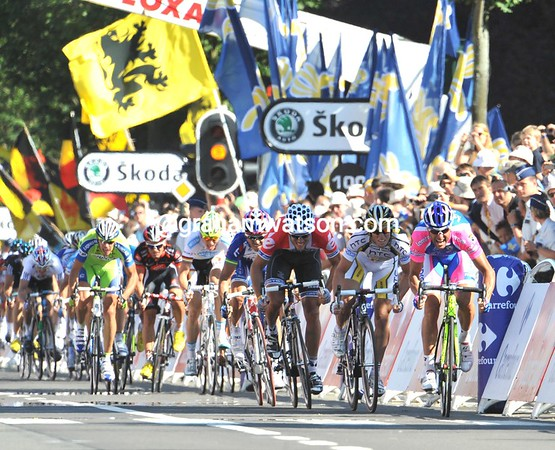 A series of crashes has decimated the peloton in the last kilometre - but the sprint is on...