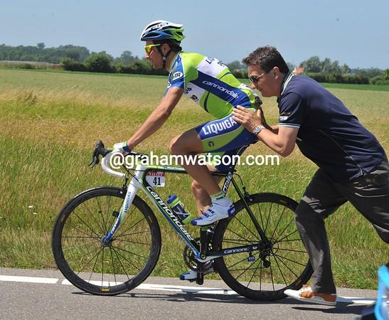 Ivan Basso needs a bike change after the crash...