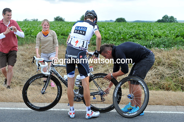 Andy Schleck needs a wheel change...