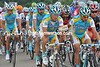 Domestic bliss for Astana - Alexandre Vinokourov passes a rain jacket to Paolo Tiralongo...
