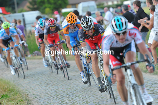 Armstrong is struggling with the brutal pace of Saxo Bank - he can barely hold the wheel of Jurgen Van den Broeck...