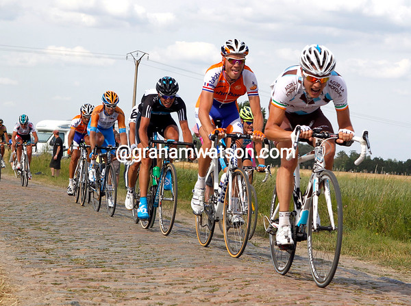 Nicholas Roche is trying desperately to keep within range of Cancellara and Hushovd...