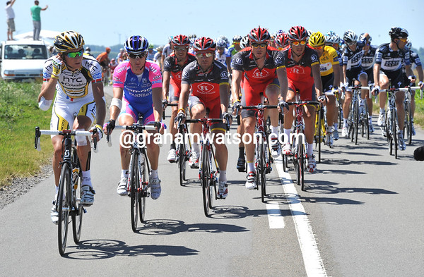 Shack is still at the head of the peloton but behind a Lampre and HTC rider now...