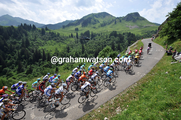 The peloton climbs towards the summit of the beautiful Col de La Colombiere...
