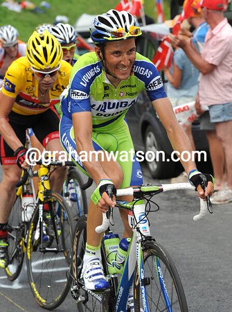 Ivan Basso and Cadel Evans are wearing masks of pain that hint at trouble to come...