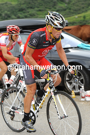 Armstrong's in the Basso group and looking relaxed about his new status in this Tour...