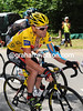A multi-coloured Cadel Evans climbs the Col de Saisies with no hint of his form for the day...