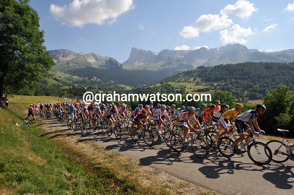 The peloton is still eleven minutes down as it starts the pretty Col de Noyer with 35-kilometres left...