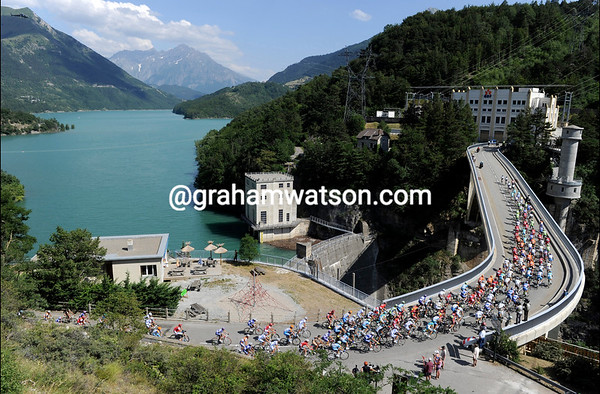 The peloton passes a stunning reservoir somewhere in the Provence-Alpes...