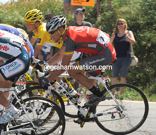Lance Armstrong chats with Schleck on a descent that, we hope, is cooling them down a bit...