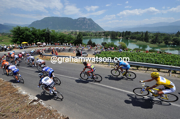 Andy Schleck is at the heart of the peloton as it descends between Savoie vineyards...