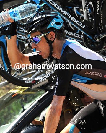 Bradley Wiggins soaks up the pleasure of an icy-cold bottle of water...