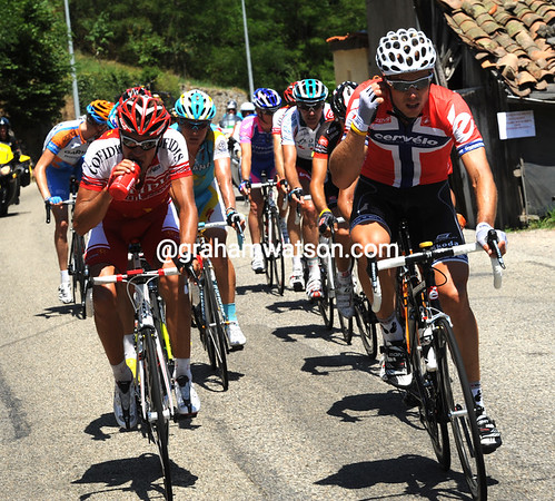 Hesjedal has helped create an 18-man escape that contains green jersey hopeful, Thor Hushovd...