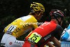 A clash of colours reveals Andy Schleck as race-leader, and Levi leipheimer's Radio Shack team as leaders of the team competition...