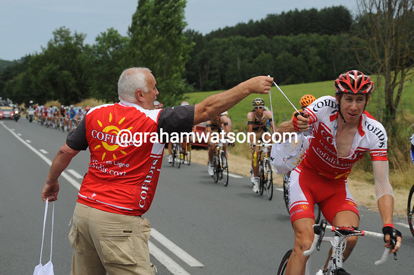 The peloton speeds through the feed-zone, and Damian Monier almost misses his lunch...