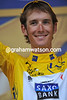 Andy Schleck just manages a smile on the podium, but he'll be thinkng more of the mountain-top finish of tomorrow's first Pyrenean stage...