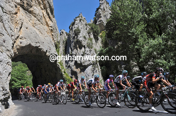 The peloton is in a gorge in Ariege, gateway to the Pyrenees in this part of the world...