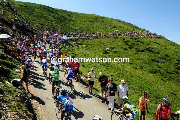 The summit of the Col de Bales is packed with spectators from France and Spain...