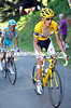 Andy Schleck and Alberto Contador have started their duel with about seven kilometres of the climb remaining...